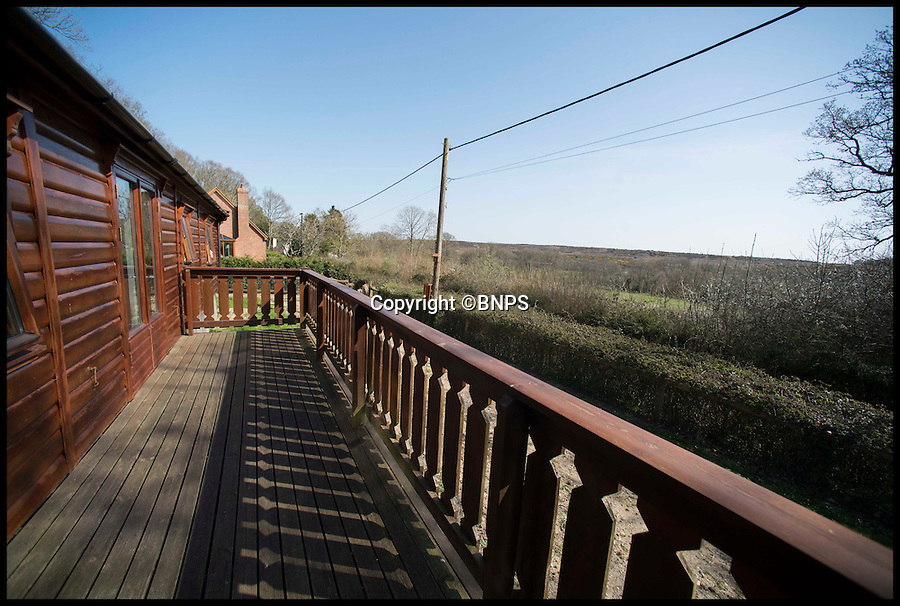 BNPS.co.uk (01202 558833)<br /> Pic: LauraDale/BNPS<br /> <br /> The balcony and view over the New Forest.<br /> <br /> A rare opportunity has arisen to own this idyllic log cabin nestled in the heart of ancient forest - but prospective buyers will have to dig deep because it comes with a whopping £350,000 price tag.<br /> <br /> The quaint wooden retreat is down a private track in the the New Forest, the medieval hunting grounds of William the Conqueror, offering peace and quiet for those looking to escape the stresses of modern life.<br /> <br /> The woodland bolthole might look like a holiday home but unlike its counterparts it comes with permission to live in it all year round.<br /> <br /> But its ideal location on the edge of a tiny hamlet in the west of New Forest National Park means it is worth more than twice what a similar holiday cabin at a home park would be worth.