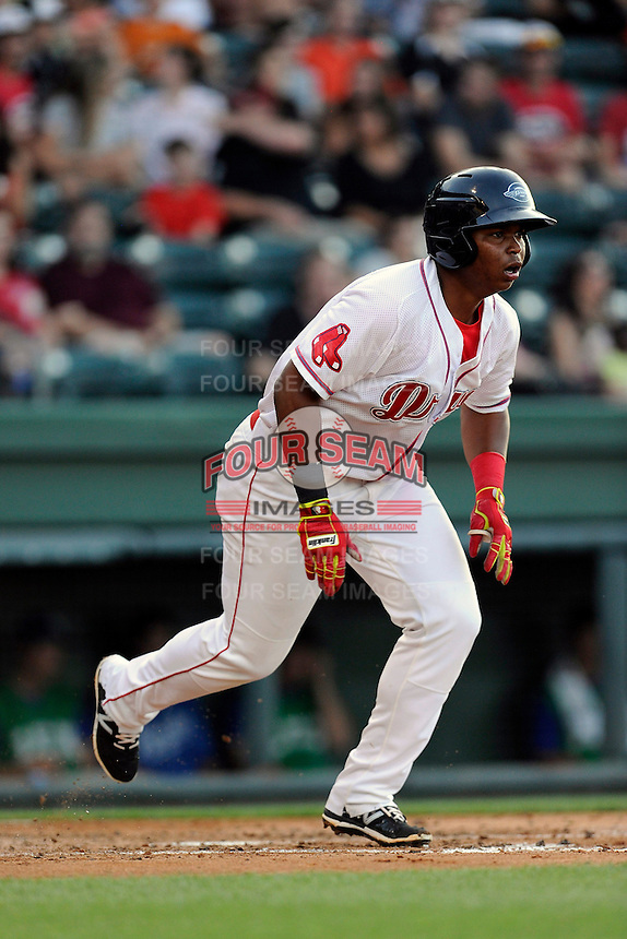 Third baseman Rafael Devers (13) of the Greenville Drive bats in a game against the Lexington Legends on Tuesday, May 19, 2015, at Fluor Field at the West End in Greenville, South Carolina. Devers is the No. 6 prospect of the Boston Red Sox, according to Baseball America. (Tom Priddy/Four Seam Images)
