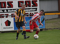 Craig Dorrat wins the ball from Jamie McHarrie in the Huntly v Wigtown & Bladnoch William Hill Scottish Cup 1st Round match, at Christie Park, Huntly on 25.8.12.