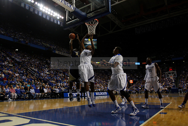 Freshman guard Darnell Dodson attempts to block Clarion's Jamar Harrison at Rupp Arena on Friday, Nov. 6, 2009. The Cats beat the Golden Eagles 117-52. Photo by Scott Hannigan | Staff