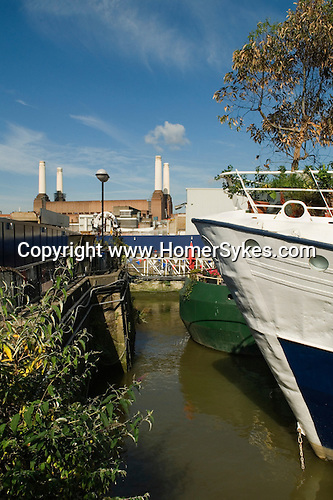 Tideway Village boathouses, Battersea South London UK . Battersea Power Station in background.  Area of redevelopment along the south bank of the River Thames.