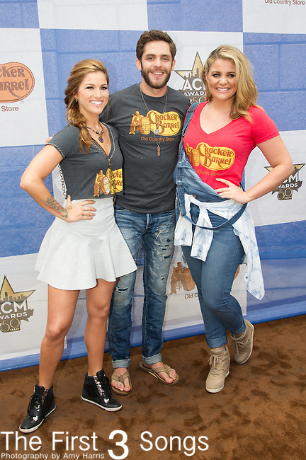 Thomas Rhett, Cassadee Pope and Lauren Alaina attend the Cracker Barrel Old Country Store Country Checkers Challenge at Globe Life Park in Arlington on April 18, 2015 in Arlington, Texas