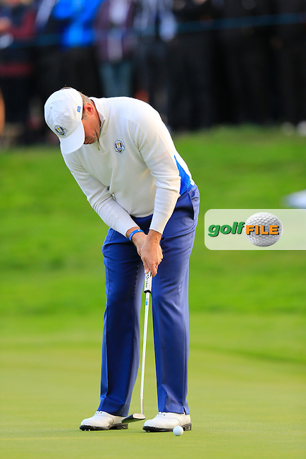 Lee Westwood (EUR) takes his putt on the 1st green during Saturday Mornings Fourball Matches between Europe's Lee Westwood and Jamie Donaldson and USA's Hunter Mahan and Jim Furyk of the Ryder Cup 2014 played on the PGA Centenary Course at the Gleneagles Hotel, Auchterarder, Scotland.: Picture Eoin Clarke, www.golffile.ie : 27th September 2014