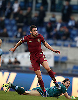 Calcio, Serie A: Lazio vs Roma. Roma, stadio Olimpico, 4 dicembre 2016.<br /> Roma&rsquo;s Kevin Strootman, top, reacts past goalkeeper Federico Marchetti after scoring during the Italian Serie A football match between Lazio and Rome at Rome's Olympic stadium, 4 December 2016. Roma won 2-0.<br /> UPDATE IMAGES PRESS/Isabella Bonotto