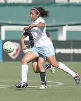 Homare Sawa #10 of Washington Freedom loses the ball to Chioma Igwe #12 of Chicago Red Stars during a WPS match at RFK Stadium on June 13 2009, in Washington D.C. The game ended in a 0-0 tie.