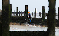 26 SEP 2010 - CLACTON, GBR - A competitor heads for transition after completing the sea swim at the Clacton Standard Distance Triathlon (PHOTO (C) NIGEL FARROW)