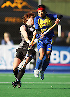 NZ's Andy Hayward and Malaysia's Hafifi Hafiz Hanafi compete for a pass during the international hockey match between the New Zealand Black Sticks and Malaysia at Fitzherbert Park, Palmerston North, New Zealand on Sunday, 9 August 2009. Photo: Dave Lintott / lintottphoto.co.nz