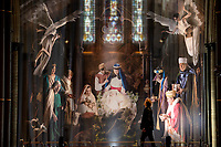 BNPS.co.uk (01202 558833)<br /> Pic: ZacharyCulpin/BNPS<br /> <br /> Pictured: Photographer Ash Mills  admires the giant nativity.<br /> <br /> One of the UK's most historic cathedrals today unveiled a 40ft Renaissance-style photographic tableau as its nativity - with its very own clergy, volunteers and staff starring as figures from the Christian scene.<br /> <br /> Salisbury Cathedral's spectacular nativity features its stonemason as Joseph, a bookings agent as Mary, a retired postman as a shepherd, a Canon and guides as Wise Men - and the son of an ex-England rugby player as baby Jesus.<br /> <br /> The Wiltshire cathedral wanted to put a modern twist on the traditional Christmas scene and cast people as Nativity characters before holding a series of individual and group photoshoots.