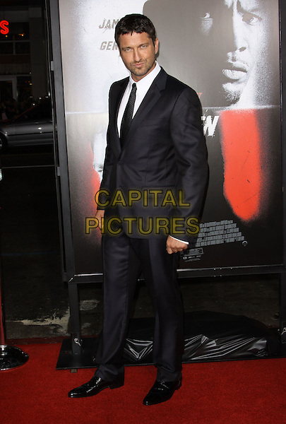 GERARD BUTLER.The Overature Film L.A. Premiere of Law Abiding Citizen held at The Grauman's Chinese Theater in Hollywood, California, USA. .October 6th, 2009 .full length grey gray suit black .CAP/ADM/KB.©Kevan Brooks/AdMedia/Capital Pictures.