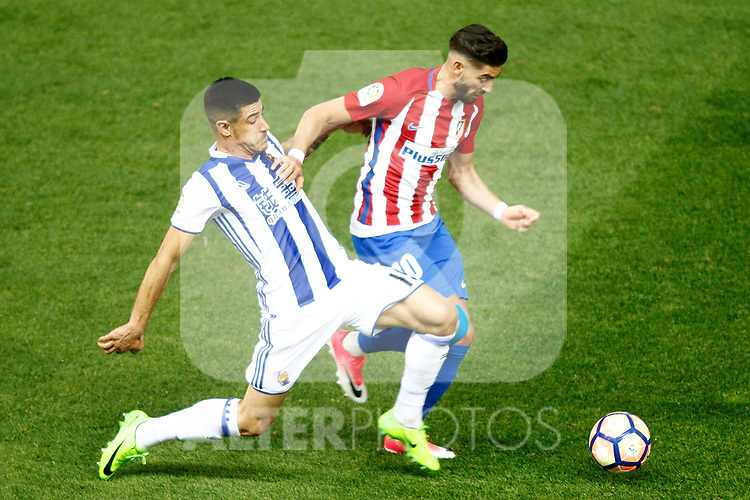 Atletico de Madrid's Yannick Ferreira Carrasco (r) and Real Sociedad's Yuri Berchiche during La Liga match. April 4,2017. (ALTERPHOTOS/Acero)