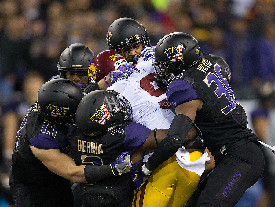 The Husky defense swarms Juju Smith-Schuster.