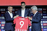 Atletico de Madrid's new player Nikola Kalinic (c) with the General Manager Andrea Berta (l) and the President Enrique Cerezo during his official presentation. August 13, 2018. (ALTERPHOTOS/Acero)