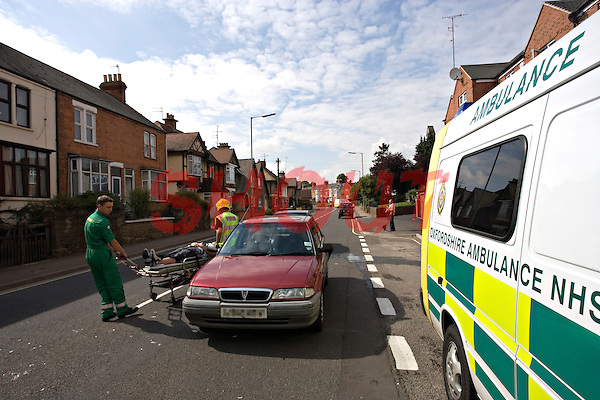Firefighters and Paramedic crews attend a road traffic accident and treat an injured driver whose car had been hit from the rear. This image may only be used to portray the subject in a positive manner..©shoutpictures.com..john@shoutpictures.com