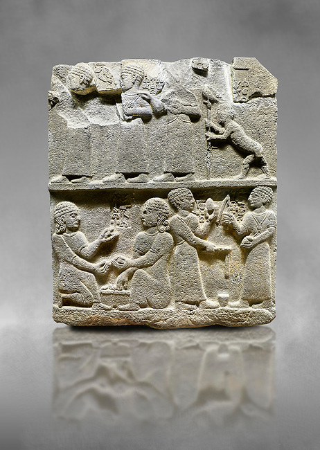 "Hittite monumental relief sculpted orthostat stone panel of Royal Buttress. Basalt, Karkamıs, (Kargamıs), Carchemish (Karkemish), 900 - 700 B.C. Anatolian Civilisations Museum, Ankara, Turkey.<br /> <br /> This panels scene showing 8 out of 10 children of the King, the hieroglyphs reads as follows: ""Malitispas, Astitarhunzas, Tamitispas,Isikaritispas, Sikaras, Halpawaris, Ya hilatispas"". Above, there are three figures holding knucklebones (astragalus) and one figure walking by leaning on a stick; below are two each figures playing the knucklebones and turning whirligigs.  <br /> <br /> Against a grey art background."