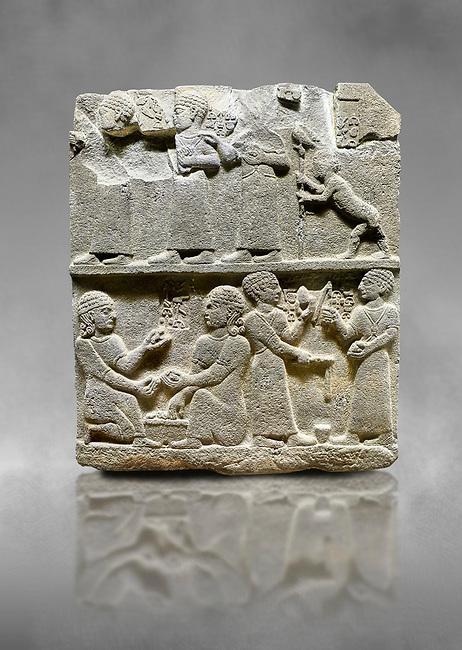"Hittite monumental relief sculpted orthostat stone panel of Royal Buttress. Basalt, Karkamıs, (Kargamıs), Carchemish (Karkemish), 900 - 700 B.C. Anatolian Civilisations Museum, Ankara, Turkey.<br /> <br /> This panels scene showing 8 out of 10 children of the King, the hieroglyphs reads as follows: ""Malitispas, Astitarhunzas, Tamitispas,Isikaritispas, Sikaras, Halpawaris, Ya hilatispas"". Above, there are three figures holding knucklebones (astragalus) and one figure walking by leaning on a stick; below are two each figures playing the knucklebones and turning whirligigs.  <br /> <br /> Against a grey art background."