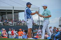 Jordan Spieth (USA) and caddie Michael Greller shake hands on 18 following round 4 of the Houston Open, Golf Club of Houston, Houston, Texas. 4/1/2018.<br /> Picture: Golffile | Ken Murray<br /> <br /> <br /> All photo usage must carry mandatory copyright credit (&copy; Golffile | Ken Murray)