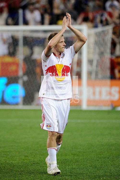 Jan Gunnar Solli (8) of the New York Red Bulls salutes the fans after the game. The New York Red Bulls defeated Toronto FC 5-0 during a Major League Soccer (MLS) match at Red Bull Arena in Harrison, NJ, on July 06, 2011.