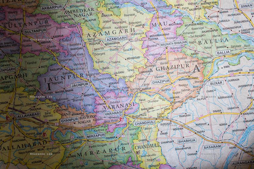 A map showing the districts near Varanasi hangs in the Guria office in Varanasi, Uttar Pradesh, India on 22 November 2013.