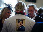 "© Joel Goodman - 07973 332324 . 14/10/2013 . Gorton Monastery , Manchester , UK . Footballer DENIS LAW (right) talks to a friend wearing a t-shirt with "" That's a Rembrandt "" as a tribute to Harry . The Humanist funeral of photographer Harry Goodwin , attended by footballers and other celebrities and featuring music by artists he had photographed including ""He Ain't Heavy, He's My Brother"" by the Hollies and "" Happiness "" by Ken Dodd . Photo credit : Joel Goodman"