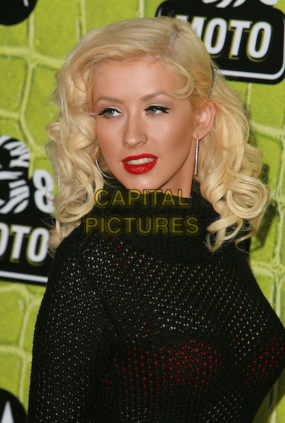 CHRISTINA AGUILERA.Motorola's 8th Anniversary Party held at the Hollywood Palladium, Hollywood, California, USA, .2 November 2006..portrait headshot black polo neck top dress red lipstick  .Ref: ADM/CH.www.capitalpictures.com.sales@capitalpictures.com.©Charles Harris/AdMedia/Capital Pictures.