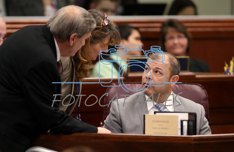 Nevada Assembly members, from left, John Ellison, R-Elko, Marilyn Kirkpatrick, D-North Las Vegas, and Paul Anderson, R-Las Vegas, work on the Assembly floor at the Legislative Building in Carson City, Nev., on Tuesday, March 3, 2015. <br /> Photo by Cathleen Allison