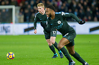 Kevin De Bruyne of Manchester City looks to pass as his team-mate Raheem Sterling makes a forward run during the EPL - Premier League match between Swansea City and Manchester City at the Liberty Stadium, Swansea, Wales on 13 December 2017. Photo by Mark  Hawkins / PRiME Media Images.