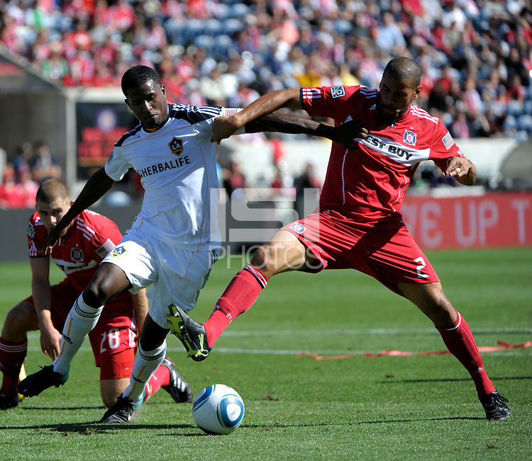 LA Galaxy forward Edson Buddle (14) battles for the ball with Chicago defender C.J. Brown (2).  The LA Galaxy tied the Chicago Fire 1-1 at Toyota Park in Bridgeview, IL on September 4, 2010