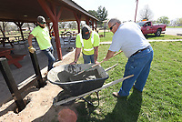 NWA Democrat-Gazette/FLIP PUTTHOFF <br /> PARK IMPROVEMENTS<br /> Dustin Phy (cq) (from left), Aaron Clark and Tom Sheets, all with the Pea Ridge parks and street department, work Wednesday installing metal trash barrel holders at the Pea Ridge City Park pavilion. The metal racks replace wooden ones that are worn out, Sheets said.