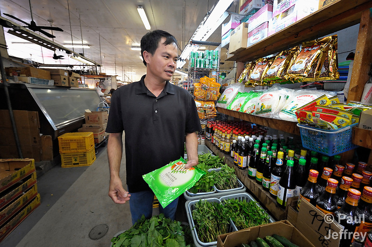 Bang Duc Nguyen, a Vietnamese survivor of human trafficking, shops for food in a market in the Chinatown neighborhood of Honolulu, Hawaii. He has received assistance from the Susannah Wesley Community Center, which has played a key role in identifying and supporting victims of trafficking in Hawaii.