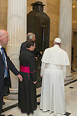 Pope Francis (R) pauses before a statue dedicated to Joseph Damien De Veuster, at the U.S. Capitol in Washington DC, USA, 24 September 2015. Pope Francis is on a five-day trip to the USA, which includes stops in Washington DC, New York and Philadelphia, after a three-day stay in Cuba. Pope Francis added the Cuba visit after helping broker a historic rapprochement between Washington and Havana that ended a diplomatic freeze of more than 50 years.<br /> Credit: Michael Reynolds / Pool via CNP