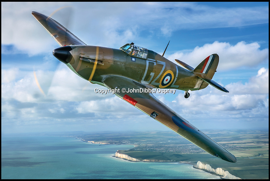 BNPS.co.uk (01202 558833)<br /> Pic: JohnDibbs/Osprey/BNPS<br /> <br /> Hurricane AE 977 still patrolling the White Cliffs of Dover 77 years after the Battle of Britain.<br /> <br /> Last of the Few - A photographer's stunning new book is a tribute to the last Hawker Hurricane's - the true workhorse of the Battle of Britain.<br /> <br /> Only 13 WW2 Hurricanes are still airworthy today, compared to over 60 of their more glamorous counterpart the Spitfire.<br /> <br /> But during the Battle of Britain there were in fact twice as many Hurricane's as Spitfires taking on Hitlers Luftwaffe in the skies over southern England.<br /> <br /> The Hurricane may be viewed as less glamorous than the Spitfire, but these stunning photographs reveal just how majestic it was in full flight.<br /> <br /> Photographer John Dibbs has got up close and personal to the legendary fighter planes in order to capture them like never before.<br /> <br /> His 10 year quest for surviving Hurricanes took him all over the world and he photographed them in England, France, the United States and New Zealand.<br /> <br /> Using the skill and experience of highly experienced RAF and civilian pilots, Mr Dibbs was able to fly to within 15ft of some of the last remaining Hurricanes - with breath-taking results.<br /> <br /> There was a fair degree of skill involved as he took the photos from the canopy of a Second World War trainer aircraft which was travelling at 200mph while confronting wind blast.<br /> <br /> The thrilling photos were taken for an a definitive history of the Hurricane which is told by Mr Dibbs and aviation historians Tony Holmes and Gordon Riley in their new book Hurricane, Hawker's Fighter Legend.