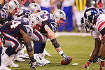 New England Patriots offensive line led by center Dan Connolly (63) lines up against the defense of the New York Giants during the NFL Super Bowl XLVI football game on Sunday, Feb. 5, 2012, in Indianapolis. The Giants won 21-17 (AP Photo/David Stluka)...