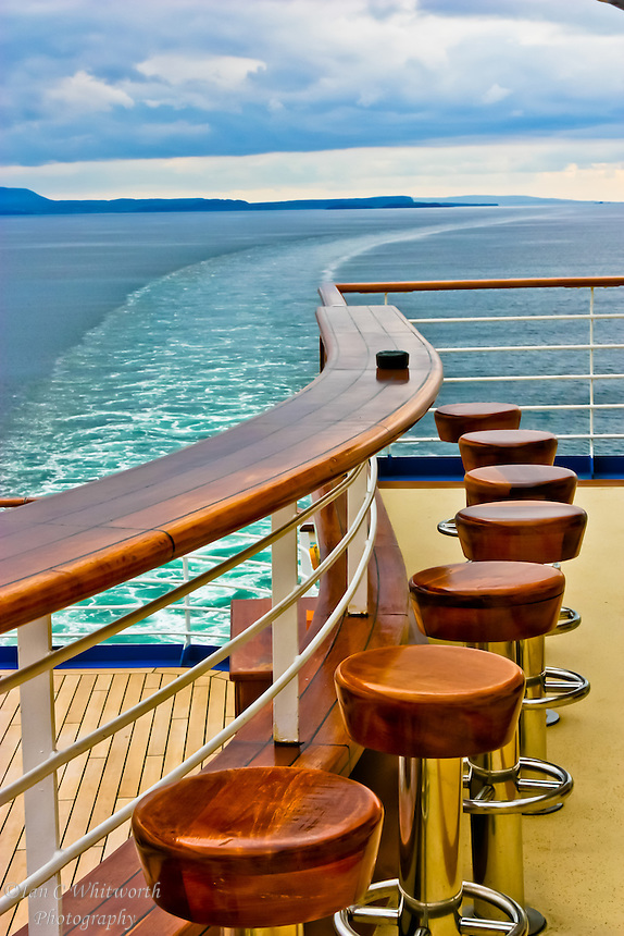 Looking at the bar at the stern of a cruise ship as it blends into the curve of the wake in the North Sea