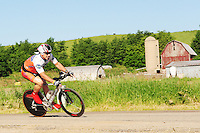 Cyclists compete in the biking competition of Badger State Summer Games on Saturday in the southern Wisconsin countryside near Marshall