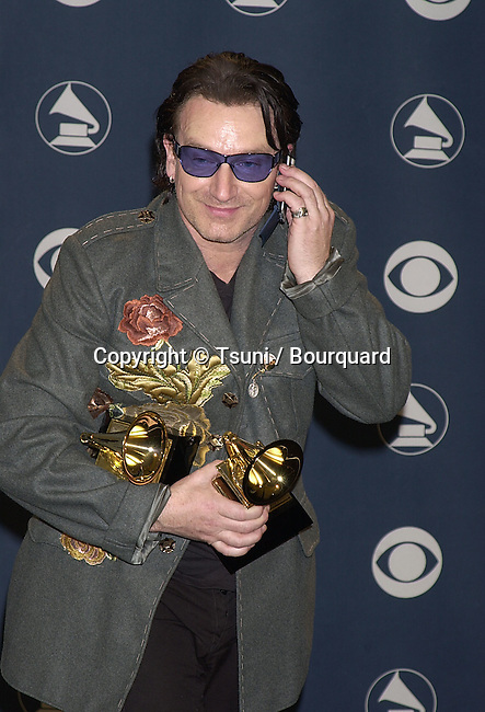 U2 Bono with his  Grammy Awards 2001 received a call from his wife  at the Stapples Pavillion in Los Angeles          -            U223.jpg
