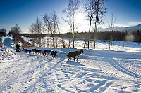 Mike Williams runs down the road after leaving the Takotna checkpoint during the 2010 Iditarod, Interior Alaska