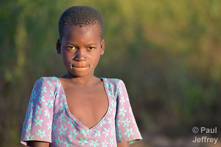A girl in Edundu, Malawi, where the Malawi Farmer-to-Farmer Agro-Ecology project of the Ekwendeni Mission Hospital AIDS Program, a program of the Livingstonia Synod of the Church of Central Africa Presbyterian, has helped families produce more food on their small farms.