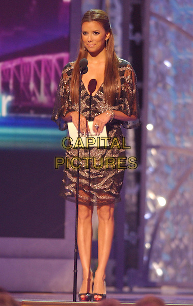 EVA LONGORIA.Presents the Male Vocalist of the Year Award. .40th Annual CMA Awards held at Gaylord Entertainment Center, Nashville, Tennessee, USA..November 6th, 2006.Ref: ADM/LF.full length stage purple sparkly dress microphone.www.capitalpictures.com.sales@capitalpictures.com.©Laura Farr/AdMedia/Capital Pictures.