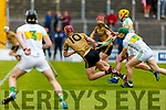 Kerry's Michael O'Leary hand passes despite the attention from Damien Egan of Offaly in the Joe McDonagh Cup relegation game in Tralee on Saturday.