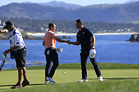 Jon Rahm (ESP) and Patrick Cantlay (USA) finish on the 18th green at Pebble Beach course during Friday's Round 2 of the 2018 AT&amp;T Pebble Beach Pro-Am, held over 3 courses Pebble Beach, Spyglass Hill and Monterey, California, USA. 9th February 2018.<br /> Picture: Eoin Clarke | Golffile<br /> <br /> <br /> All photos usage must carry mandatory copyright credit (&copy; Golffile | Eoin Clarke)