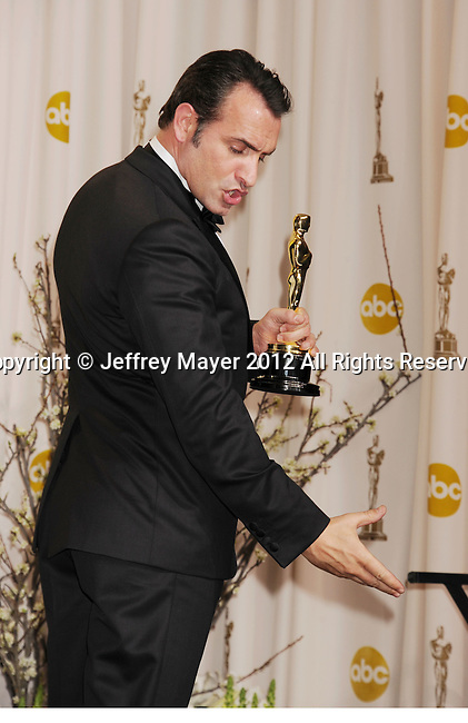 HOLLYWOOD, CA - FEBRUARY 26: Jean Dujardin poses in the press room at the 84th Annual Academy Awards held at Hollywood & Highland Center on February 26, 2012 in Hollywood, California.