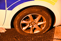 Pictured: A vanmdalised tyre on a police car in Monkton, Pembrokeshire, Wales, UK. Tuesday 11 July 2017<br /> Re: A riot broke out in a quiet country village when more than 200 protesters threw stones and lit fires outside the house of a woman they suspected of being a sex offender.<br /> The angry mob shouting 'paedo' and 'nonce' were broken up by at about 4am when the 24-year-old woman and another person were escorted from the house by armed police.<br /> The crowd had gathered in Monkton, Pembrokeshire just after 9pm on Tuesday night after a series of sex allegations against the woman were made on Facebook.