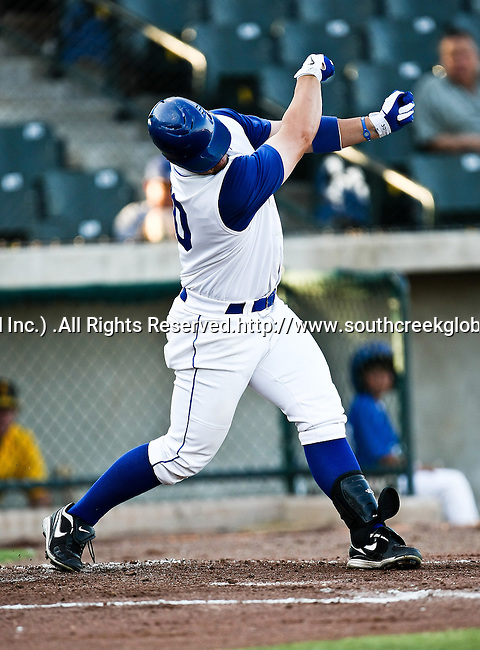 Fort Worth Cats 1st Baseman John Allen (30) loses his bat during the American Association of Independant Professional Baseball game between the Amarillo Sox and the Fort Worth Cats at the historic LaGrave Baseball Field in Fort Worth, Tx. Fort Worth defeats Amarillo 5 to 3.