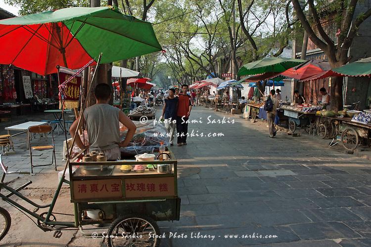Vendors line a street in Daqingzhen Si, Muslim District, Xian, Shaanxi, China.