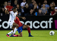 HOUSTON, TX - FEBRUARY 03: Crystal Dunn #19 of the USA and Maria Coto #3 of Costa Rica make contact after going for the ball during a game between Costa Rica and USWNT at BBVA Stadium on February 03, 2020 in Houston, Texas.