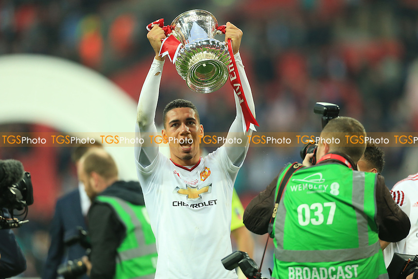 Chris Smalling of Manchester United celebrates with the trophy during Crystal Palace vs Manchester United, Emirates FA Cup Final Football at Wembley Stadium on 21st May 2016
