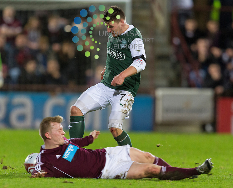 Hearts v Hibernian  SPL season 2012-2013 ..Andrew Driver slides in on Gary Deegan during the Clydesdale Bank Premier League match between Hearts and Hibernian at Tynecastle Stadium on Thursday 3 January 2013..Picture: Alan Rennie. Universal News & Sport