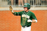 Shane Brown #1 of the Charlotte 49ers high fives a teammate after scoring a run against the Missouri Tigers at Robert and Mariam Hayes Stadium on February 27, 2011 in Charlotte, North Carolina.  Photo by Brian Westerholt / Four Seam Images