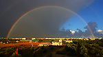 A rainbow shines over Above farmland after heavy rain poured in Khan Younis in the southern Gaza strip, Friday, October 31, 2014. Photo by Ramadan El-agha