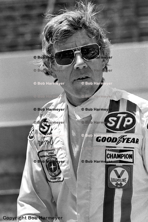 INDIANAPOLIS, INDIANA: Gordon Johncock walks through the pit lane before practice for the Indianapolis 500 on May 29, 1977, at the Indianapolis Motor Speedway.
